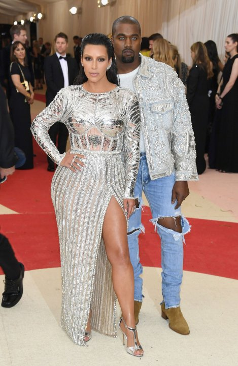 Kim Kardashian West in Balmain and Kanye West in Fear of God