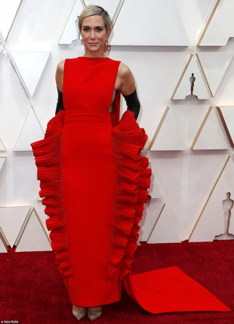 Kristen Wiig's dress resembled a caterpillar thanks to the double layer of ruffles that ran down each side of the very structured skirt