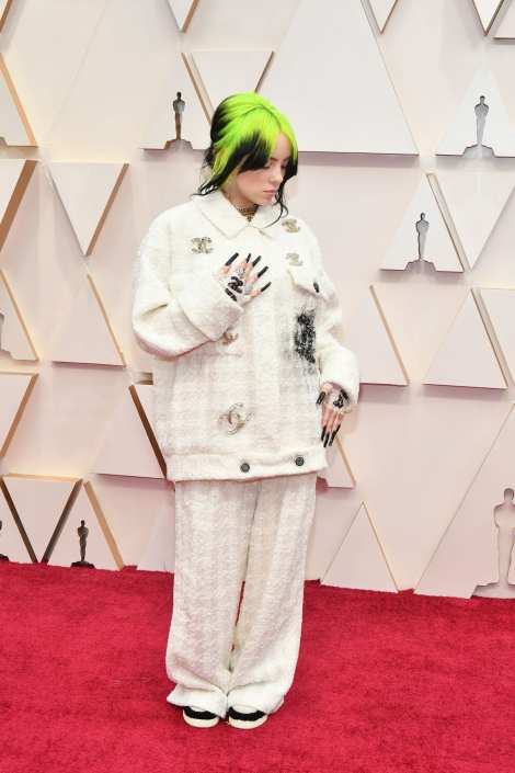 The singer wore a gorgeous white Chanel jacket on the red carpet, complete with several Chanel accessories.Billie Eilish